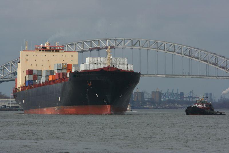 Bigstockphoto_Ocean_Vessel_And_Tug_Boat_4215645