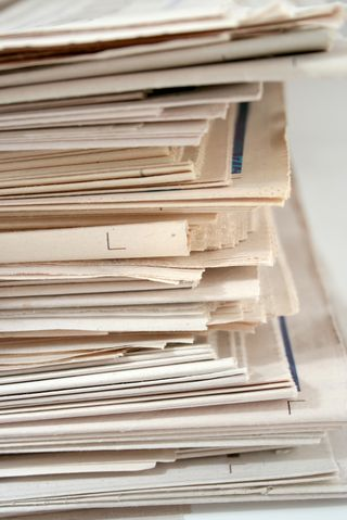 Bigstockphoto_Newspaper_Stack_573795