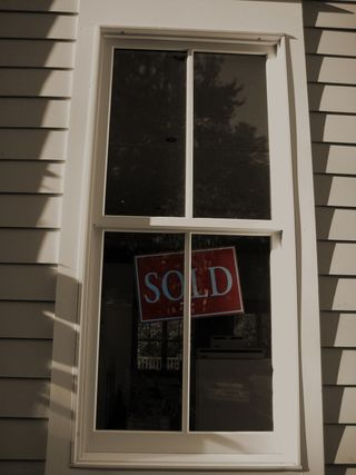 Bigstockphoto_Window_With_Sign_Sold__3653862